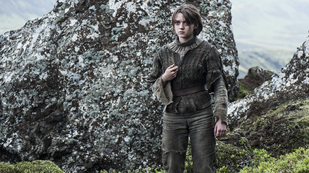 maisie williams arya stark in front of rock game of thrones